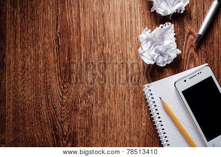 Office Supplies On Wooden Table With Copy Space
