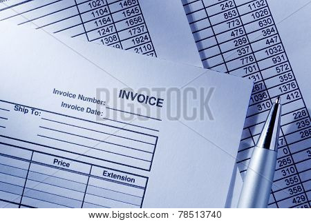 Invoice And Spreadsheet With A Pen