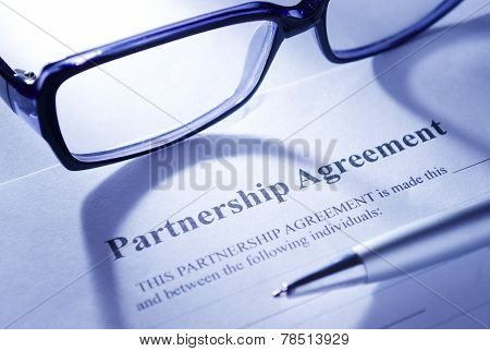 Close Up Glasses And Pen On Top Of Agreement Paper