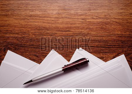 Pen And Paper On Wooden Table With Copy Space