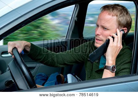 Young Man Is Calling In The Car