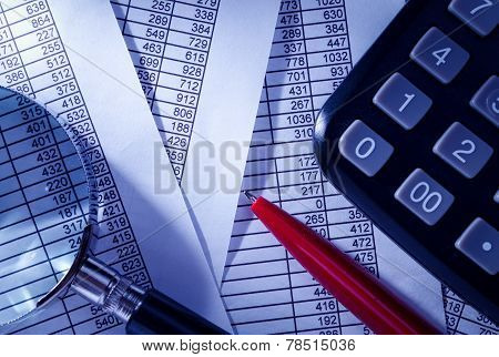 Calculator And Pen On Top Of Paper Reports