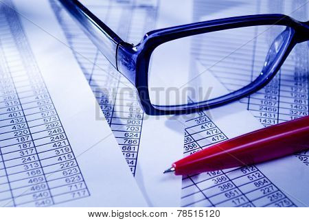 Eyeglasses And Pen On Top Of Documents