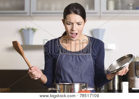 Young Housewife Having A Calamity In The Kitchen