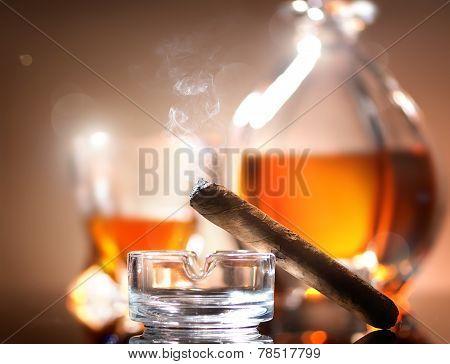 Cigar on ashtray