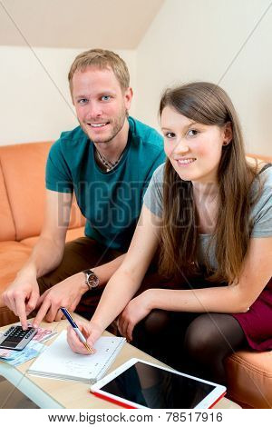 Young Couple Counting Her Money
