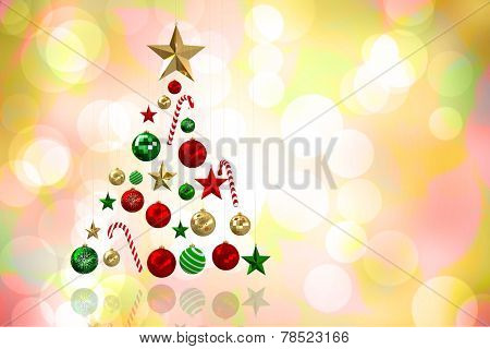 Christmas tree shape of baubles against girly pink and yellow pattern