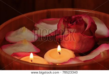 Rose Petals, Candles  And Rose In Bowl With Water. Selective Focus On The Candle