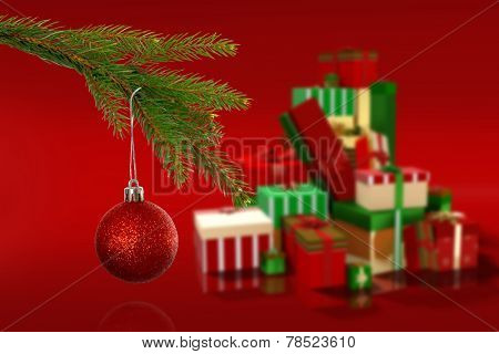 Composite image of Red christmas bauble hanging from branch against red vignette