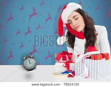 Brown hair in santa hat napping against blue and purple reindeer pattern