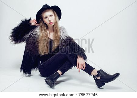 young blonde teenage girl in hat and fur coat, fashion dressed lathy model
