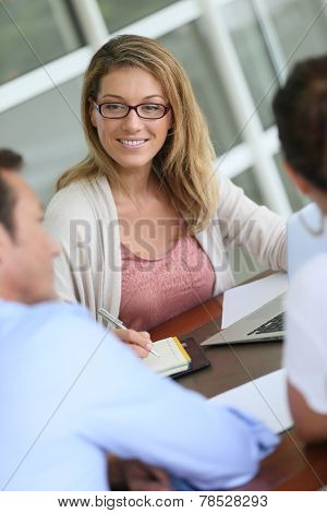 Financial adviser meeting with couple in office
