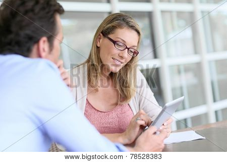 Businesswoman in business meeting using tablet