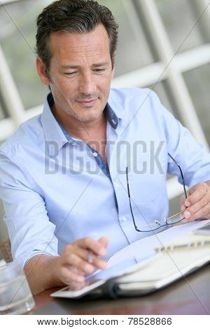 Portrait of businessman using digital tablet
