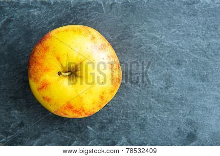 Closeup On Apple On Stone Substrate