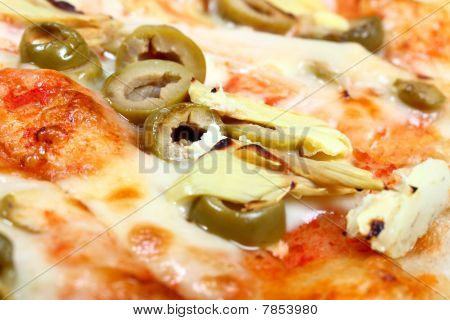 Fresh baked pizza with olives and artichokes
