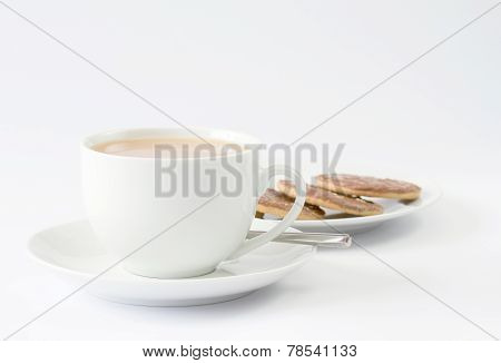 Cup of tea with plate of chocolate biscuits