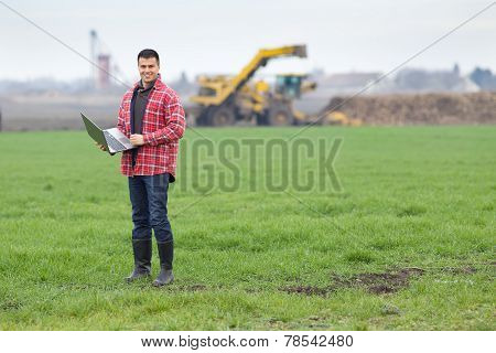 Peasant With Laptop In Field