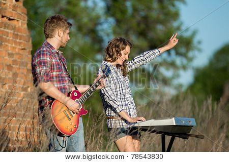 Couple Playing Music