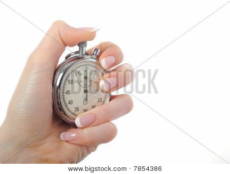 Beautiful Womans Hand With Stop Watch. Isolated On White Background