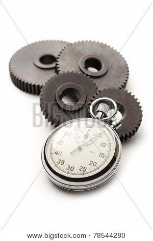 Four Steel Cogwheels And Stopwatch