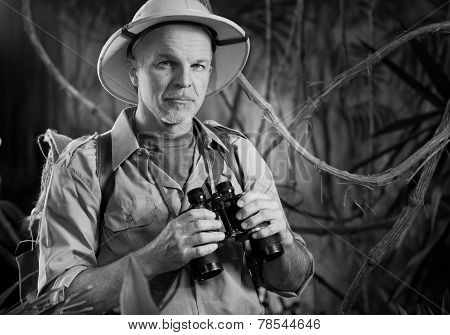 Adventurer In The Jungle With Binoculars