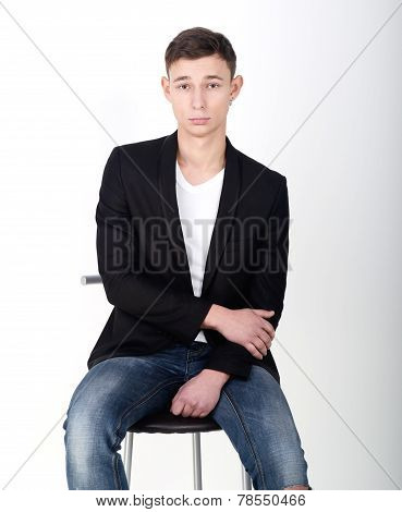Handsome male model in suit with sports shirt