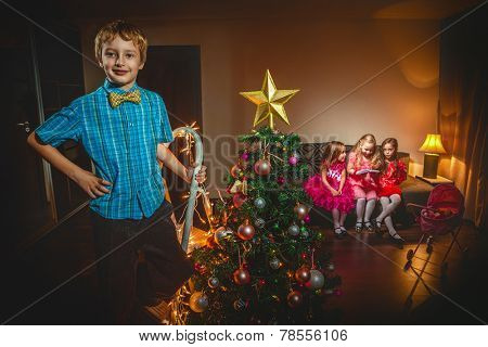 Group of children in Christmas hat with adorable girls play with toy carriage