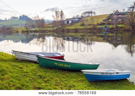 ZAWOZ, POLAND, NOVEMBER 09, 2014: Fishing boats moore on shore of Solina Lake in Bieszczady