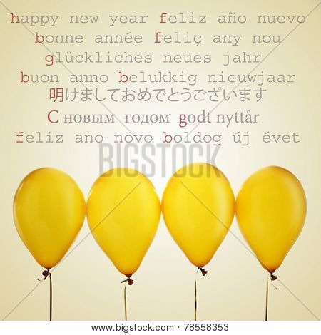 some golden balloons and the text happy new year written in different languages, such as spanish, french, catalan, german, russian or japanese