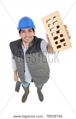 Man proudly showing his brick.
