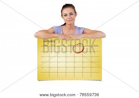Young female looking over a wall against january calendar