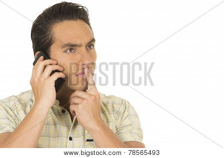 young handsome hispanic man posing using cell phone