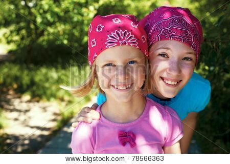 Two Little Girls Outdoors In Kerchiefs On Their Heads