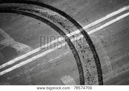 Crossing Of Double Dividing Lines Road Marking And Tires Track