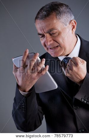 An Old Man Angry With A Tablet