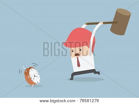 Businessman Is Trying To Smash Alarm Clock By Using Big Hammer