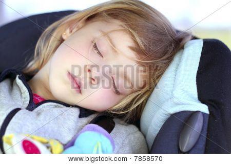 Little Girl Sleeping On Children Car Safety Seat