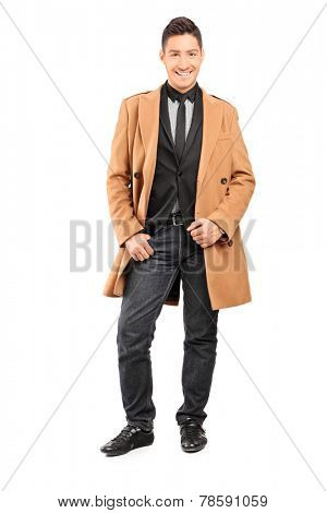 Full length portrait of a fashion model posing in classy clothes isolated on white background
