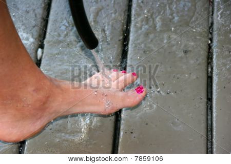 Woman Spraying Feet