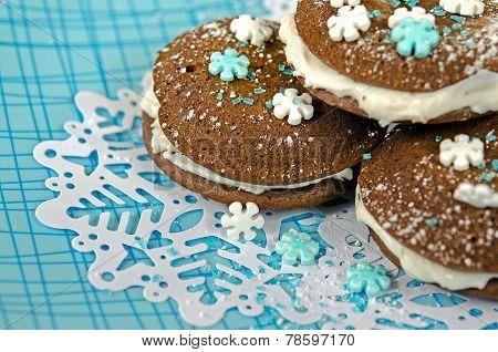 Chocolate whoopie pies on snowflake