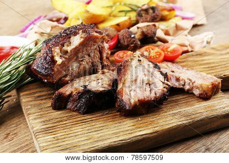 Delicious grilled meat on table