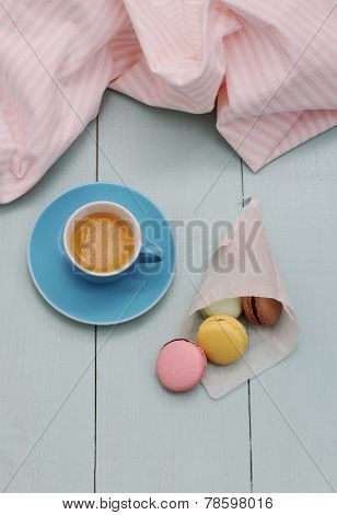 Macarons In Backing Paper Cornet And Blue Espresso Cup