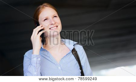 Woman Calling By Phone In A City