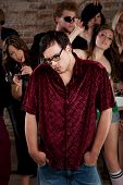 stock photo of peer-pressure  - Nerdy loner at a 1970s Disco Music Party - JPG