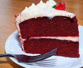 stock photo of red velvet cake  - Red velvet cake on a plate with a fork - JPG