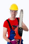 stock photo of gunslinger  - wild man with helmet and chain saw  - JPG