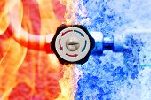stock photo of controller  - manual heating controller with red and blue arrows in fire and ice background - JPG