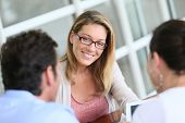 picture of 35 to 40 year olds  - Businesswoman meeting with couple to sign financial contract - JPG