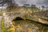 picture of upstream  - Gordale Bridge over Gordale Beck is just upstream from Janets Foss near Malham - JPG